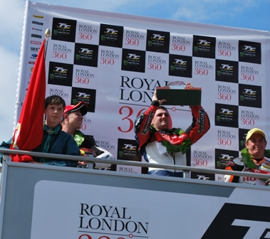 Michael Dunlop lifts the trophy after taking the win in the RL360° Superstock TT race